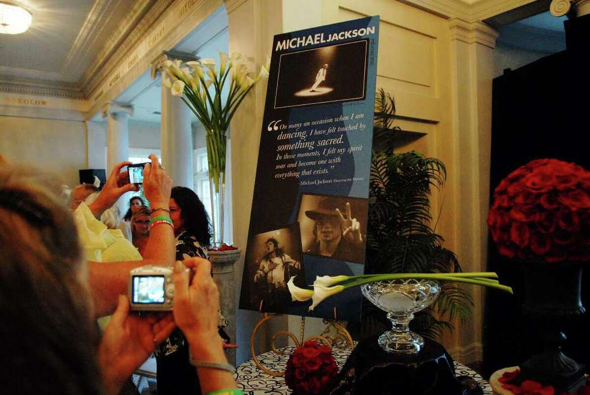 Fans of Michael Jackson take photographs of the plaque that honors the singer during the ceremony to induct Michael Jackson into the Mr. & Mrs. Cornelius Vanderbilt Hall of Fame at the National Museum of Dance in Saratoga Springs on Sunday, Aug. 15, 2010. (Paul Buckowski / Times Union)