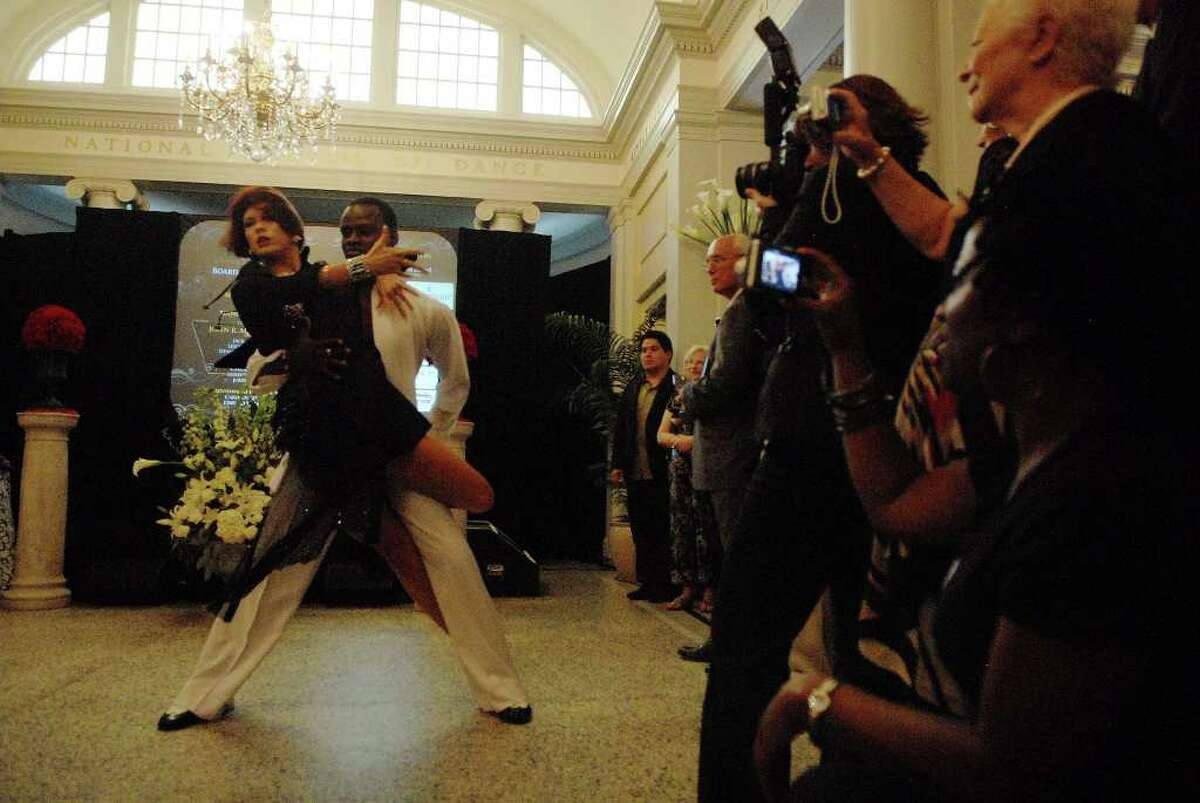 Saratoga Springs Arthur Murray Dance Studio dancers Iraeda Boldina and Ricardo Sopin perform to the music of Michael Jackson during the ceremony to induct Michael Jackson into the Mr. & Mrs. Cornelius Vanderbilt Hall of Fame at the National Museum of Dance in Saratoga Springs on Sunday, Aug. 15, 2010. (Paul Buckowski / Times Union)