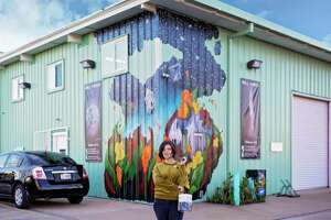 """Artist Jessica Rice with her Arts District Houston mural """"As the Little Houses Go"""" at 1903 Spring St."""