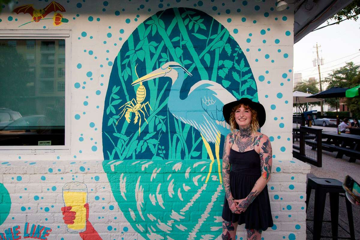 Jade Young with a detail of her new mural