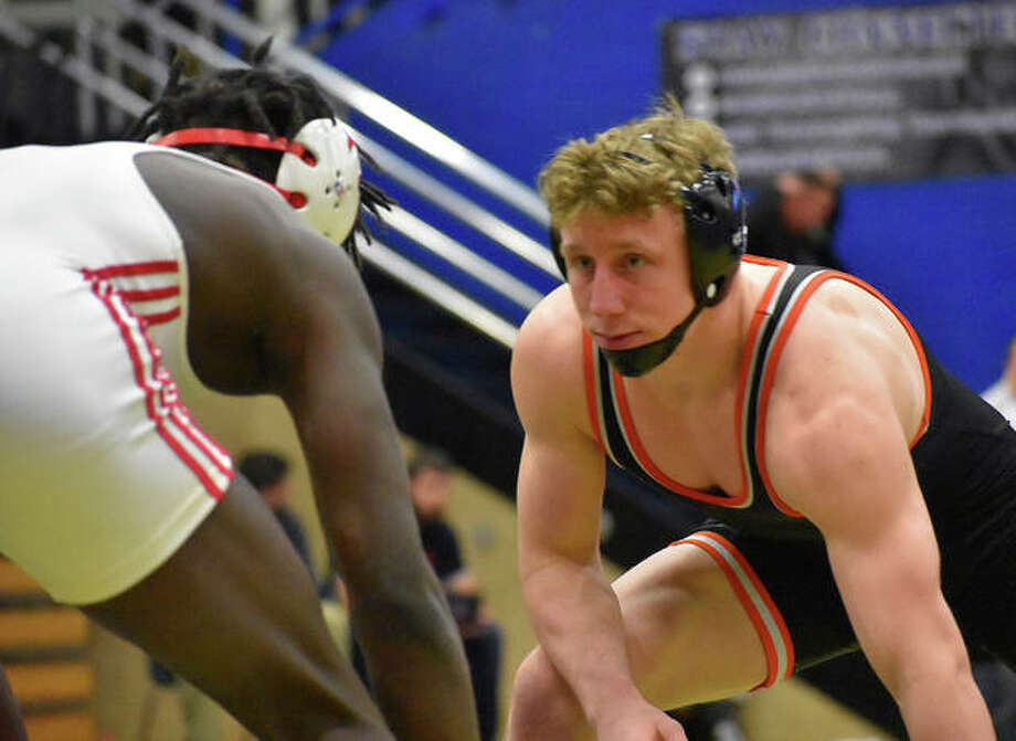 Edwardsville's Luke Odom, right, prepares to wrestle in the Class 3A Quincy Sectional semifinal match for 160 pounds on Saturday.