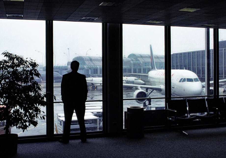 Business travelers are rethinking travel plans, according to the Global Business Travel Assn. Photo: Jim Glab