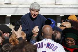 Former Illinois Gov. Rod Blagojevich acknowledges Chicago Cubs' fam Ronnie Woo Woo after a news conference outside his home Wednesday, Feb. 19, 2020, in Chicago. On Tuesday, President Donald Trump commuted Blagojevich's 14-year prison sentence for political corruption.