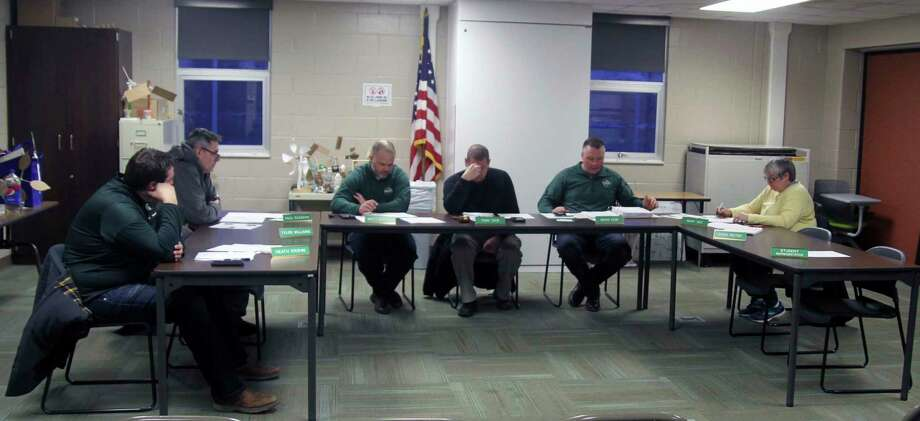The Laker Schools Board of Education discusses an agenda item at a recent meeting. (Eric Rutter/Huron Daily Tribune)