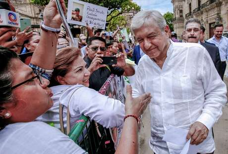 Mexican President Andres Manuel Lopez Obrador greets people in Guadalajara. In an interview with Spanish-language network Telemundo, Democratic presidential hopefuls Tom Steyer and Sen. Amy Klobuchar couldn't remember his name.