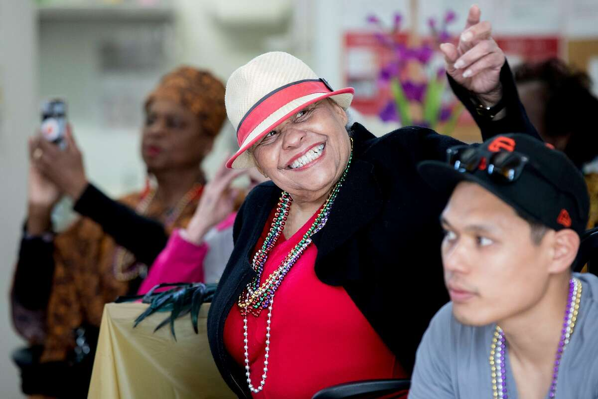 Ingleside neighbor Edna James smiles at a friend while attending a community Mardi Gras celebration held at the IT Bookman Community Center in the Ingleside neighborhood of San Francisco, Calif. Saturday, February 15, 2020. This local get-together was organized by Ms. Edna James, a longtime New Orleans resident who relocated to the neighborhood following Hurricane Katrina, with support from the Oceanview Library branch manager Lynne Maes.