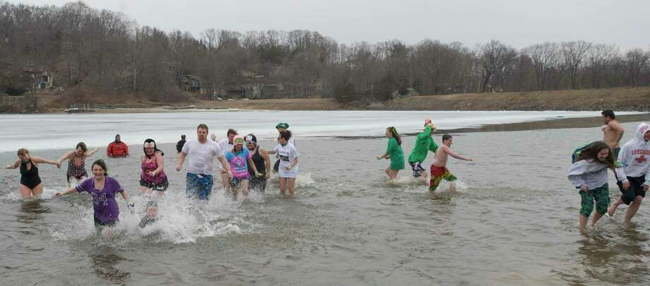 File photo of an earlier plunge at Candlewood Lake to raise money and awareness for the Special Olympics. Photo: H John Voorhees III / H John Voorhees III / The News-Times Freelance