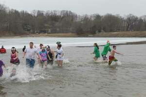 File photo of an earlier plunge at Candlewood Lake to raise money and awareness for the Special Olympics.