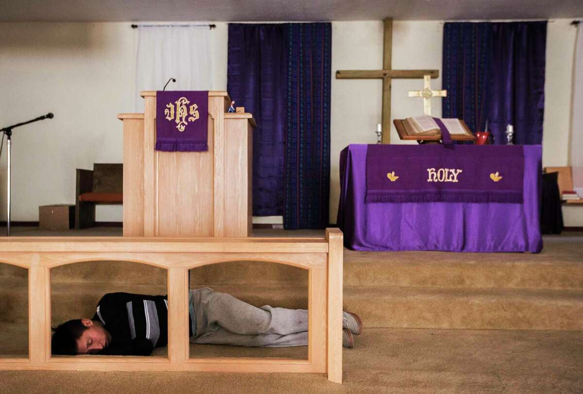 Luis Pelico, 16, takes a nap in the sanctuary of the El Calvario Methodist Church on Thursday, April 4, 2019, in Las Cruces. Pelico came across into the United States with his father and they are both from Guatemala. After three days on detention, the pair was release by the immigration authorities to a shelter the Methodist church runs in New Mexico.