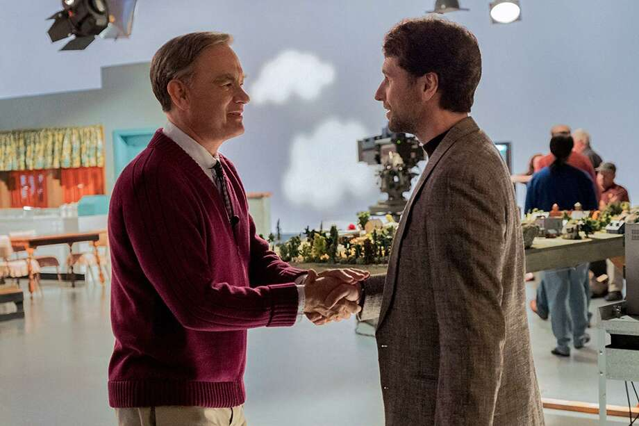 """Reassuring television host Fred Rogers (Tom Hanks) meets skeptical journalist Lloyd Vogel (Matthew Rhys) in director Marielle Heller's unconventional biopic, """"A Beautiful Day in the Neighborhood."""" (Lacey Terrell/Sony Pictures/TNS) Photo: Lacey Terrell/Sony Pictures, HO / TNS / IMDb"""