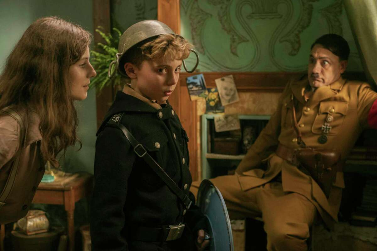 This image released by Fox Searchlight Pictures shows, from left, Thomasin McKenzie, Roman Griffin Davis, and Taika Waititi in a scene from the WWII satirical film