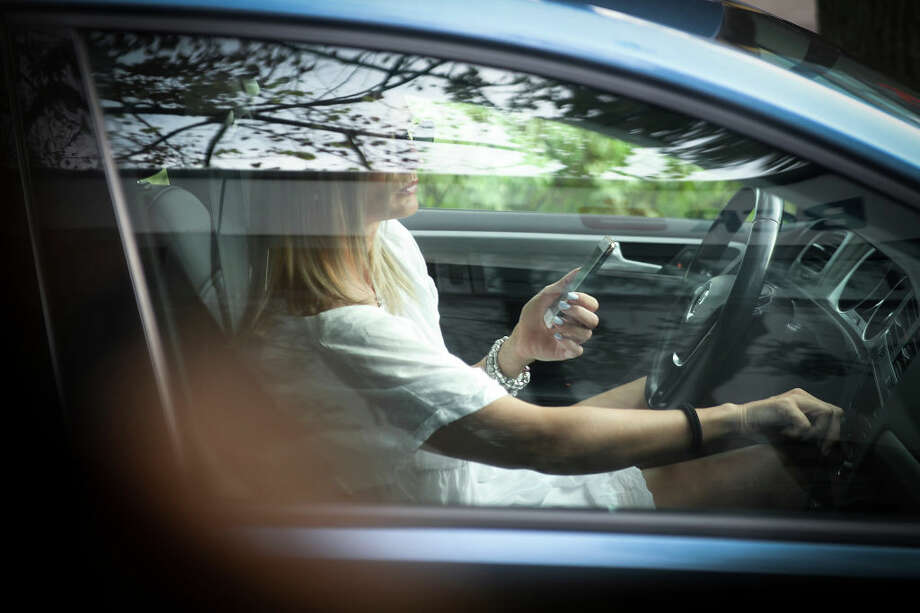 Click through the slideshow to see the most common questions about distracted driving in Washington. Photo: Jaap Arriens/NurPhoto Via Getty Images / Jaap Arriens/NurPhoto