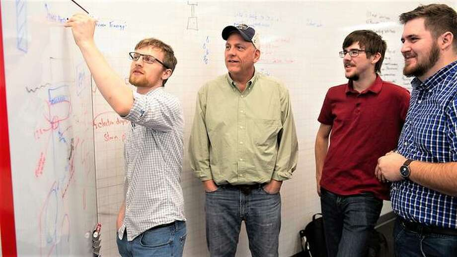 A team of Southern Illinois University Edwardsville students shares their startup idea with a mentor during the 3-Day Startup Feb. 7-9.