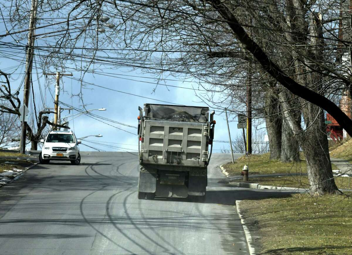 A truck heads up Partition Street after leaving the Dunn Landfill on Wednesday, Feb.19, 2020, in Rensselaer, N.Y. (Will Waldron/Times Union)