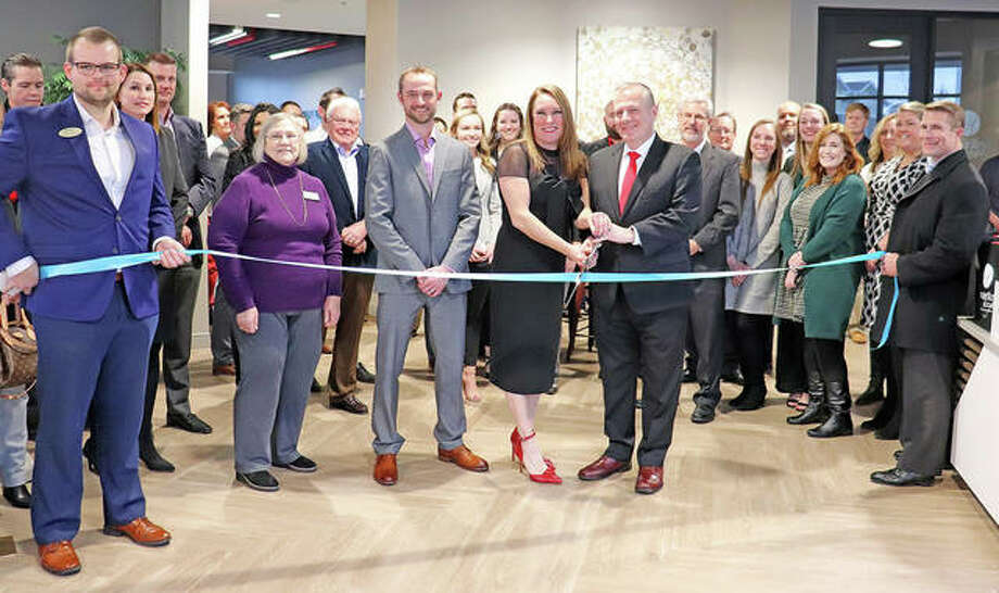 Holland Construction and Fireside Financial hosted a ribbon-cutting ceremony Feb. 6 to mark the grand opening of Whispering Heights South Tower. Photo: Courtesy Of Fireside Financial