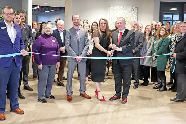 Holland Construction and Fireside Financial hosted a ribbon-cutting ceremony Feb. 6 to mark the grand opening of Whispering Heights South Tower.