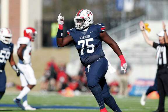 Atascocita Eagles Kam Dewberry (75) celebrates after a score during the first half of the high school football playoff game between the between the North Shore Mustangs and the Atascocita Eagles at Sheldon ISD Panther Stadium in Houston, TX on Saturday, December 7, 2019. The Mustangs lead the Eagles 41-21.