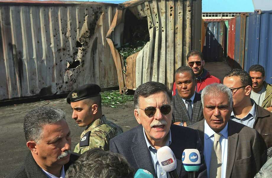 Prime Minister of Libya's UN-recognized Government of National AccordFayez al-Sarraj speaks to the media during his visit to the port in the capital Tripoli after it was hit by rocket fire on Wednesday. Photo: MAHMUD TURKIA, AFP Via Getty Images / AFP or licensors