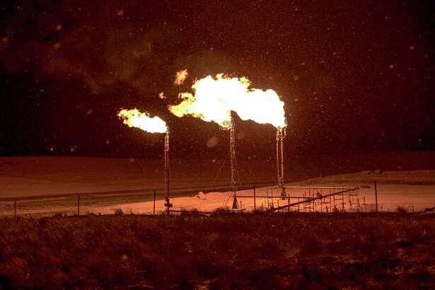 FILE - Gas flares on the Fort Berthold Reservation in North Dakota on Nov. 16, 2018. Oil and gas production may be responsible for a far larger share of the soaring levels of methane, a powerful greenhouse gas, in the earth?•s atmosphere, new research has found. (Gabriella Demczuk/The New York Times)