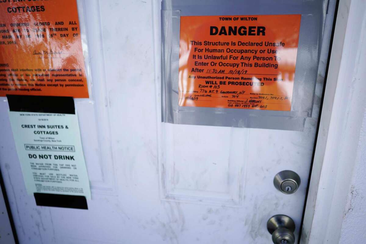 A view of one of the doors to a room at the now closed down Crest Inn motel, seen here on Wednesday, Feb. 19, 2020, in Gansevoort, N.Y. (Paul Buckowski/Times Union)
