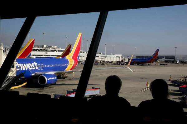 Travelers wait in Terminal 1 for a Southwest flight to Honolulu at Oakland International Airport in Oakland, Calif. Thursday, January 30, 2020. The airport has had a year of ups and downs, with large airlines such as Norwegian and JetBlue rerouting away from Oakland and to SFO, but at the same time Southwest has expanded its services out of Oakland to Hawaii, leaving the promise of even more travelers making their way through the terminals of Oakland International Airport.