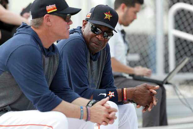 Houston Astros manager Dusty Baker Jr. talks with former Astros second baseman and Hall of Famer Craig Biggio while they watched Josh James pitch a live batting practice during the Houston Astros spring training workouts at the Fitteam Ballpark of The Palm Beaches, in West Palm Beach , Wednesday, Feb. 19, 2020.