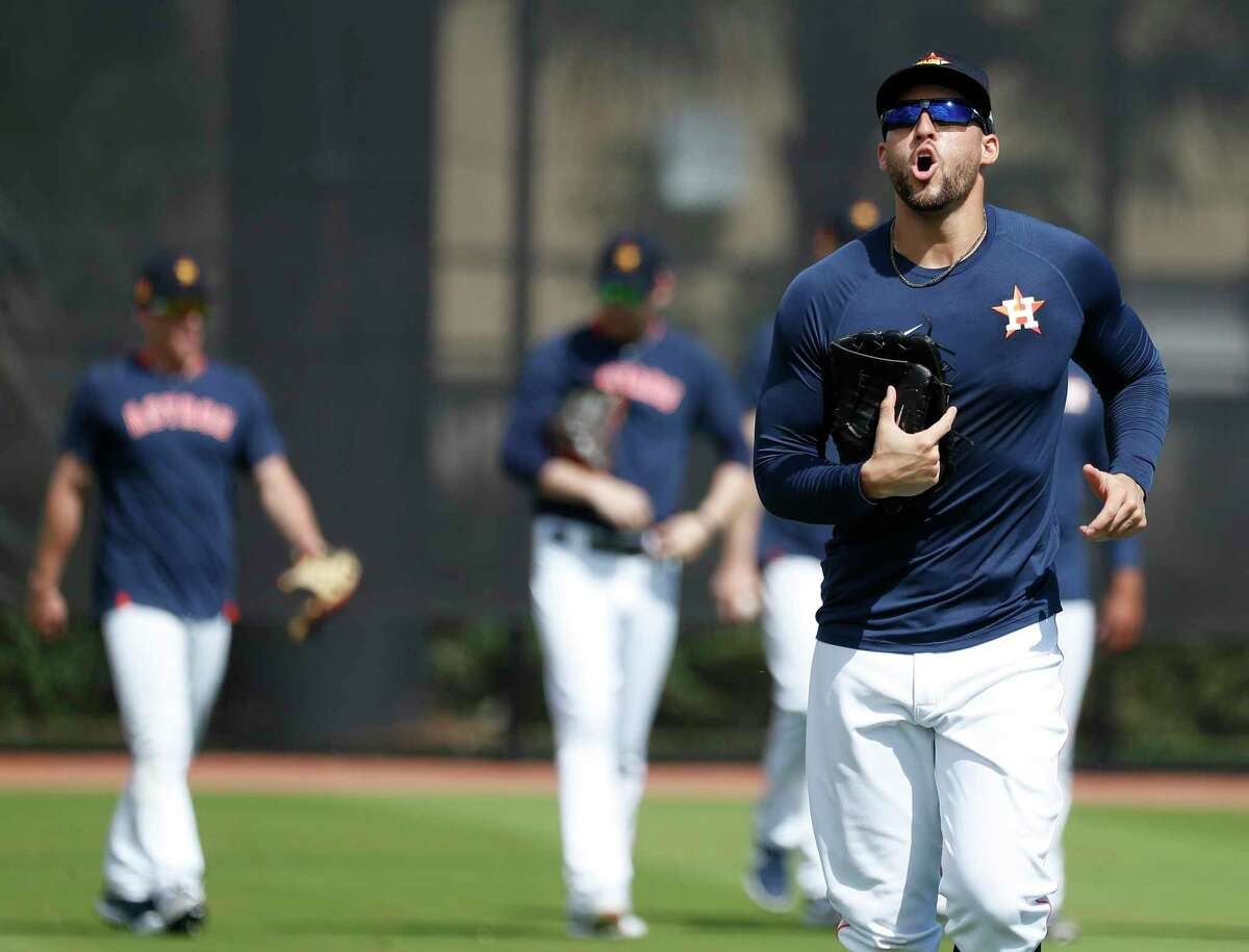Houston Astros outfielder George Springer (4) yells as he and other outfielders come off the field during the Houston Astros spring training workouts at the Fitteam Ballpark of The Palm Beaches, in West Palm Beach , Wednesday, Feb. 19, 2020.