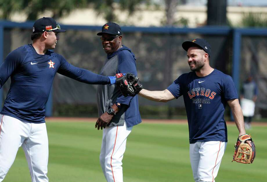 PHOTOS: Everything you need to know about new Astros manager Dusty Baker Houston Astros Jose Altuve and Aledmys Diaz high-five after infield drills with manager Dusty Baker Jr. during the Houston Astros spring training workouts at the Fitteam Ballpark of The Palm Beaches, in West Palm Beach , Wednesday, Feb. 19, 2020. Photo: Karen Warren, Staff Photographer / © 2020 Houston Chronicle