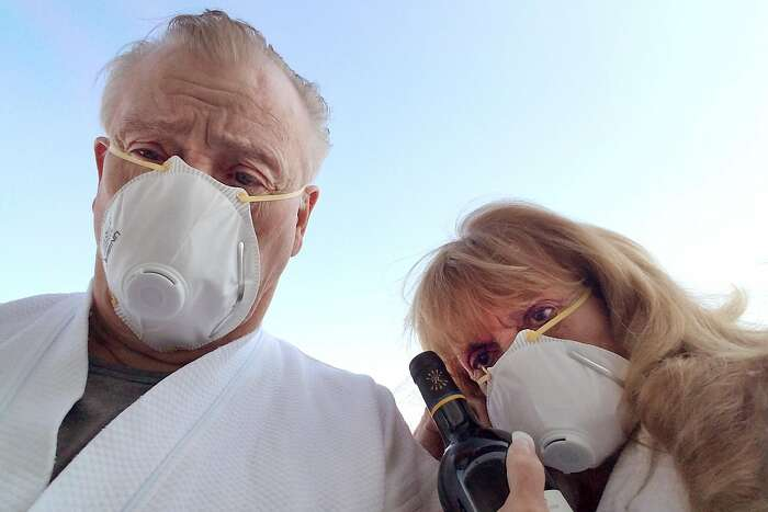 Otis and Carol Menasco are seen while quarantined on the Diamond Princess in Yokohama, Tokyo, Japan. The Menascos were aboard the Diamond Princess cruise ship, hard hit by the virus, and evacuated by plane to Lackland Air Force Base in Texas.