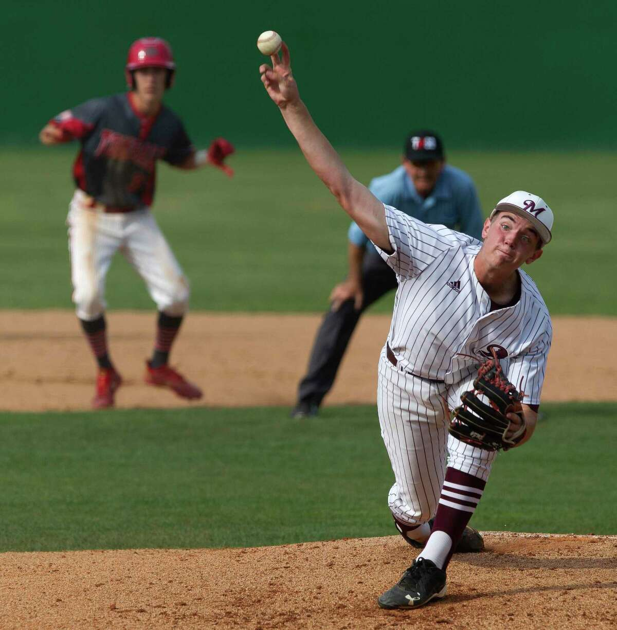 Magnolia starting pitcher Brady Loving (35) throws in the second inning of Game 2 during a Region III-5A bi-district high school baseball playoff series at Tomball High School, Thursday, May 2, 2019, in Tomball.