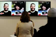 """WWE Superstar Roman Reigns, who appears on screen via Skype, surprises Make-A-Wish recipient Israel """"Izzy"""" Rodriguez, a 12-year-old Hartford resident who has leukemia, by telling Rodriguez is going to WrestleMania. The surprise reveal was made live during the studio production of WWE's The Bump on Feb. 19, 2020 at the WWE studios at 88 Hamilton Ave., in Stamford, Connecticut. Rodriguez was a guest on the show hosted by WWE personality Kayla Braxton."""