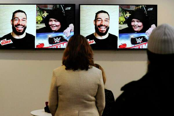 "WWE Superstar Roman Reigns, who appears on screen via Skype, surprises Make-A-Wish recipient Israel ""Izzy"" Rodriguez, a 12-year-old Hartford resident who has leukemia, by telling Rodriguez is going to WrestleMania. The surprise reveal was made live during the studio production of WWE's The Bump on Feb. 19, 2020 at the WWE studios at 88 Hamilton Ave., in Stamford, Connecticut. Rodriguez was a guest on the show hosted by WWE personality Kayla Braxton."