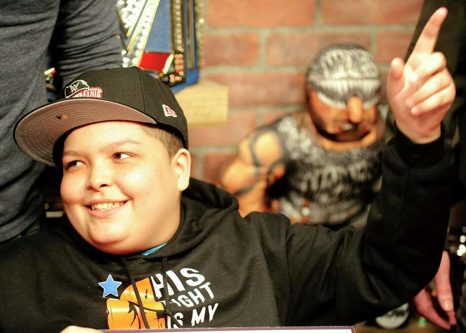 Make-A-Wish recipient Israel Rodriguez, a 12-year-old Hartford resident who has leukemia, learned during a live stream production of WWE's The Bump, from WWE Superstar Roman Reigns via Skype, that he will be attending WrestleMania. The surprise reveal was made at the digital and production studio's of the WWE in Stamford, Conn. on Feb. 19, 2020. The show is hosted by WWE personality Kayla Braxton. Photo: Matthew Brown / Hearst Connecticut Media / Stamford Advocate