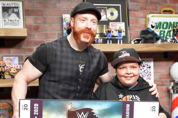 Make-A-Wish recipient Israel Rodriguez, a 12-year-old Hartford resident who has leukemia, meets WWE Superstar Sheamus following the live taping of WWE's The Bump on Feb. 19, 2020 in Stamford, Connecticut. Rodriguez learned that he would be attending Wrestlemania during a surprise reveal.