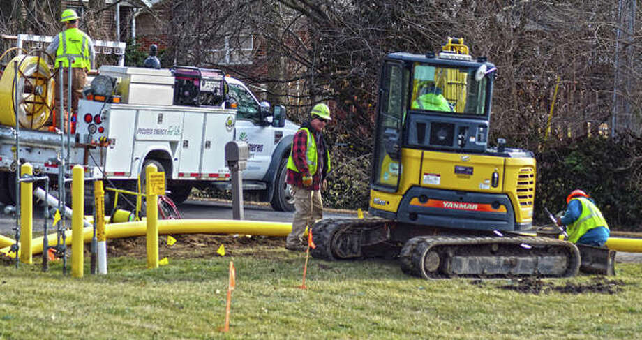 Crews work to repair a water main struck by Ameren Illinois gas crew Wednesday afternoon in Maryville near Bluffview Baptist Church, located near Route 157 and Hill Creek Road. Photo: Tyler Pletsch | The Intelligencer