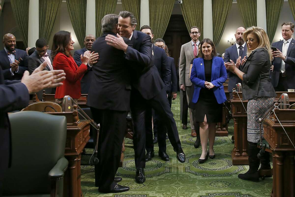 California Gov. Gavin Newsom, center, is greeted by Democratic state Sen. Robert Hertzberg, as he enters the Assembly Chambers to give his State of the State address to a joint session of the legislature at the Capitol in Sacramento, Calif., Wednesday, Feb. 19, 2020. (AP Photo/Rich Pedroncelli, Pool)