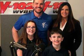 Featured is Tyler Schuberg and his wife, Marcie, with their two children, Jaelynn and Bash. The photo was taken as they recorded their new commercial for the radio in celebration of Schuberg Insurance Agency's 75-year anniversary. (Courtesy photo)