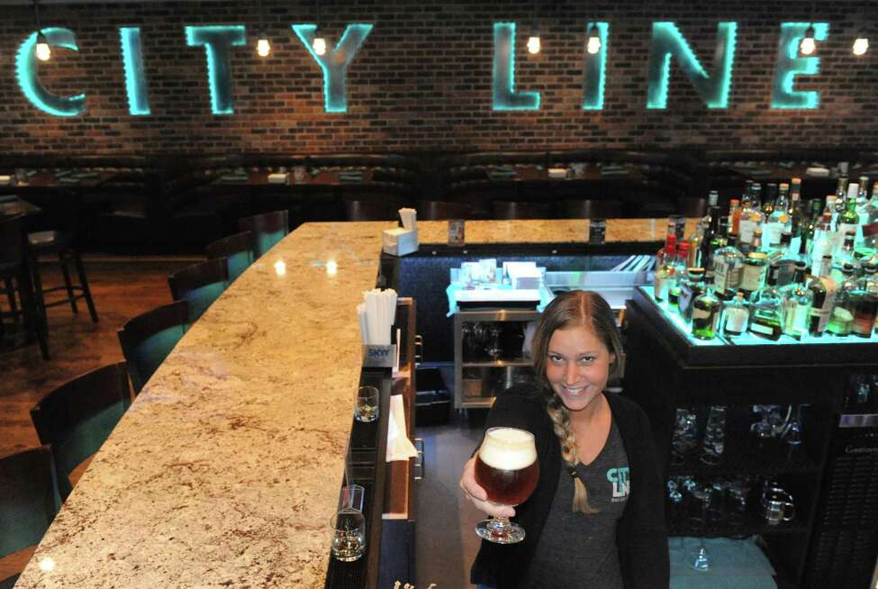 Bartender Dawn KilPatrick at the City Line Bar and Grill on Friday Nov. 7, 2014 in Albany, N.Y. (Michael P. Farrell/Times Union)