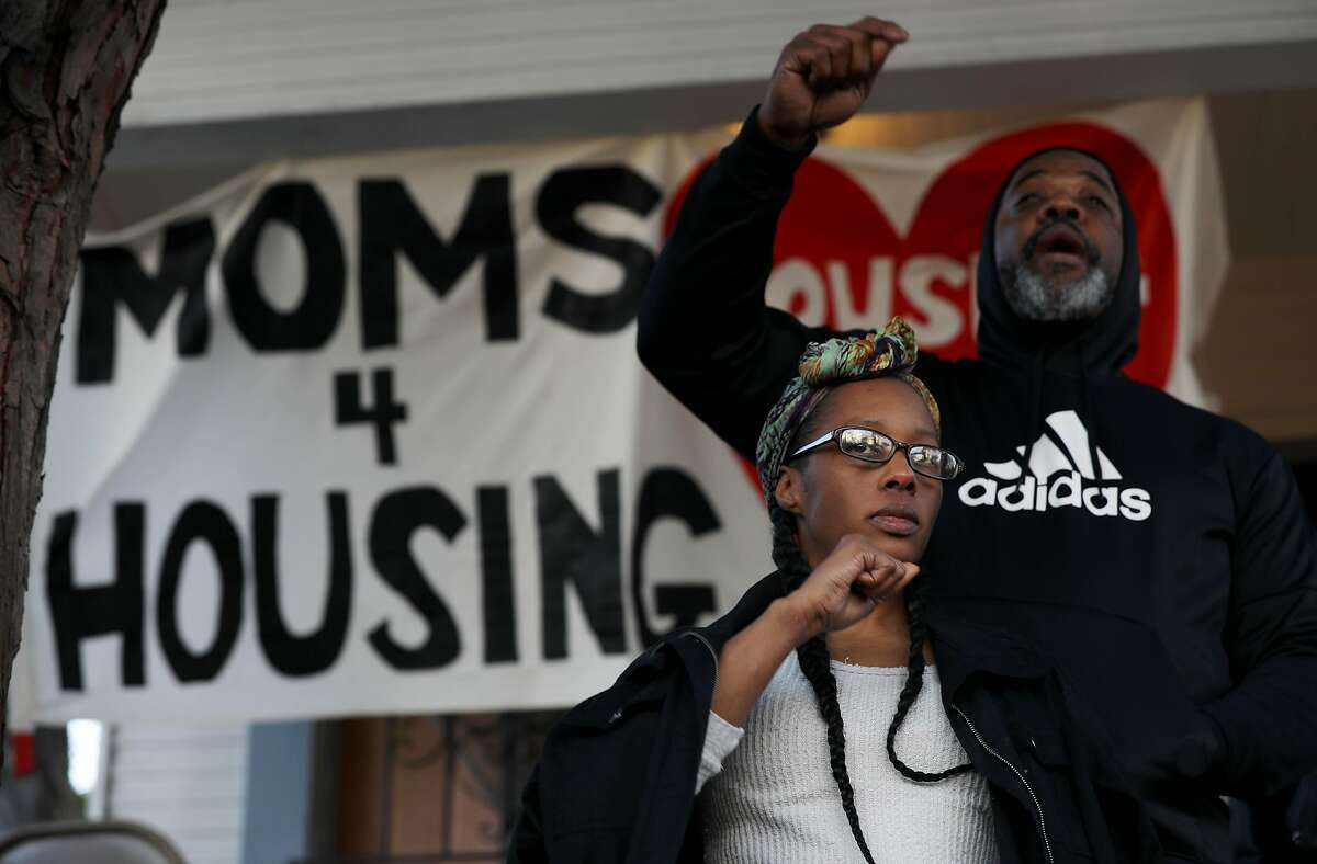 Dominique Walker, co-founder, Moms 4 Housing, and Tur-Ha, with Community Ready Core, stand on porch steps of the Magnolia Street house Walker and other homeless mothers had been occupying as they face supporters following an eviction in Oakland, Calif., on Tuesday, January 14, 2020. Moms 4 housing members Misty Cross and Tolani King were arrested early Tuesday morning. A third person, Jesse Turner, was also arrested. A judge on Friday ruled that Moms 4 Housing didn't have a legal right to the property and that they would be evicted by the Sheriff's Office within days.