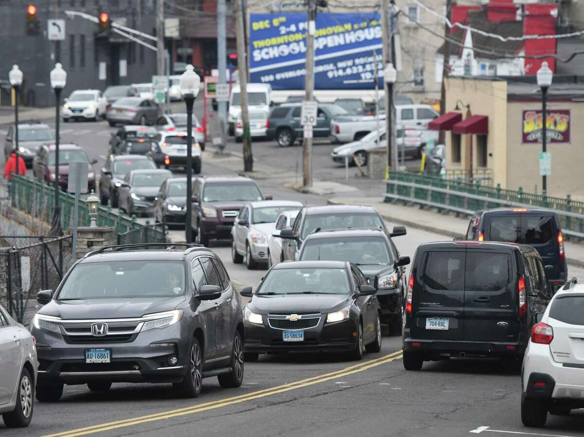 Traffic is heavy on the Mill Street Bridge in the area near a proposed apartment and retail building in Port Chester, N.Y.