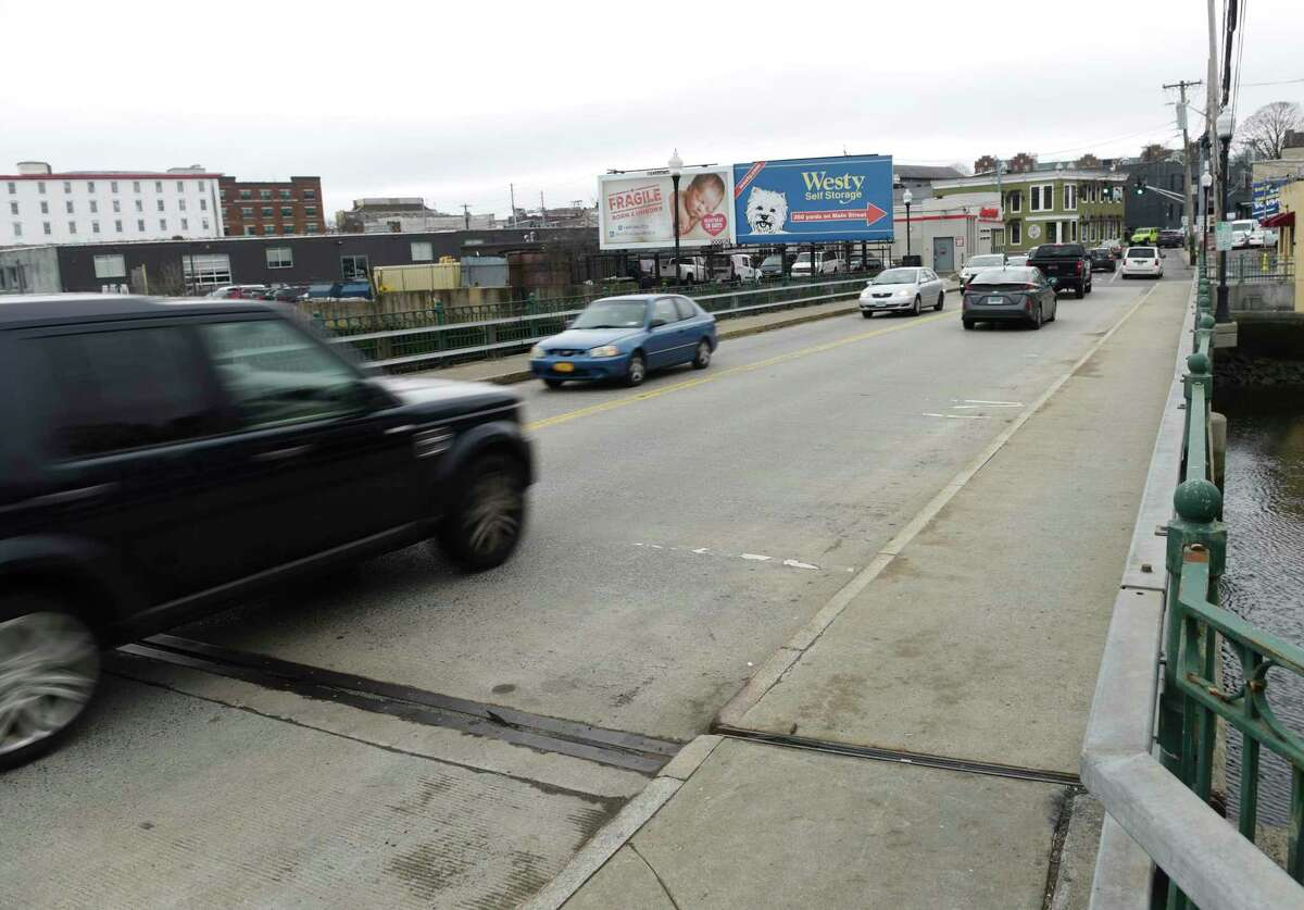 Traffic is heavy on the Mill Street Bridge in the area near a proposed apartment and retail building in Port Chester, N.Y. The site - the old Tarrylodge - can be seen in the background.