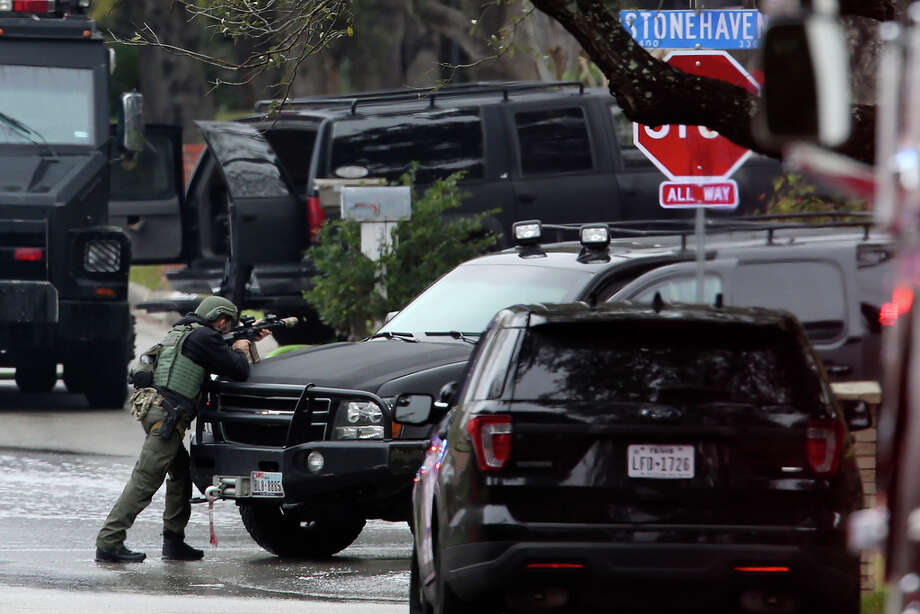 A SWAT member stands ready outside a of a house on the 3400 block of Stonehaven Road, Wednesday, Feb. 19, 2020. According to San Antonio Police Chief William McManus, a man 29-year-old male barricaded himself in the house after they responded to a vehicle fire at the scene. His body was later found on the second floor. Photo: Jerry Lara, San Antonio Express-News / **MANDATORY CREDIT FOR PHOTOG AND SAN ANTONIO EXPRESS-NEWS/NO SALES/MAGS OUT/TV   © 2019 San Antonio Express-News