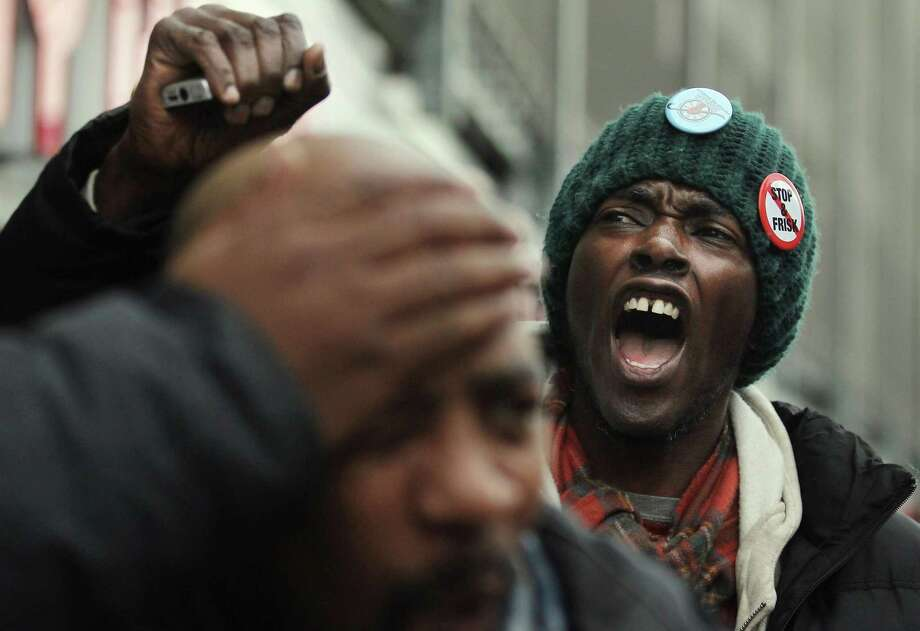 """Opponents of the New York Police Department's """"stop-and-frisk"""" policy march in 2012. Mayor Michael Bloomberg thought to stop crime, he had to control black and brown residents. Under Bloomberg, Muslims, received similar, unwarranted scrutiny. Photo: Mario Tama /Getty Images / 2012 Getty Images"""