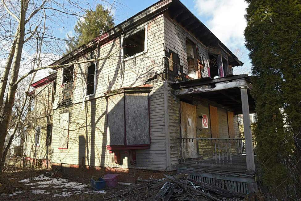 Building at 705 3rd Ave. on Wednesday, Feb. 19, 2020 in Troy, N.Y. This is one of eight buildings the city of Troy is advertising to demolish. (Lori Van Buren/Times Union)