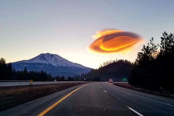 It's not a UFO, it's a cloud, says the U.S. Forest Service. The glowing object was photographed by a Shasta McCloud Management Unit Fire Management officer near Mt. Shasta on Feb. 13, 2020.