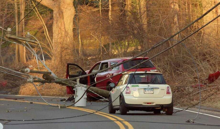 Police, fire and utility crews responded to a two car accident on Dodgingtown Road, with wires trapping an occupant in one of the cars. Wednesday afternoon, february 19, 2020, in Bethel, Conn. Photo: H John Voorhees III / Hearst Connecticut Media / The News-Times