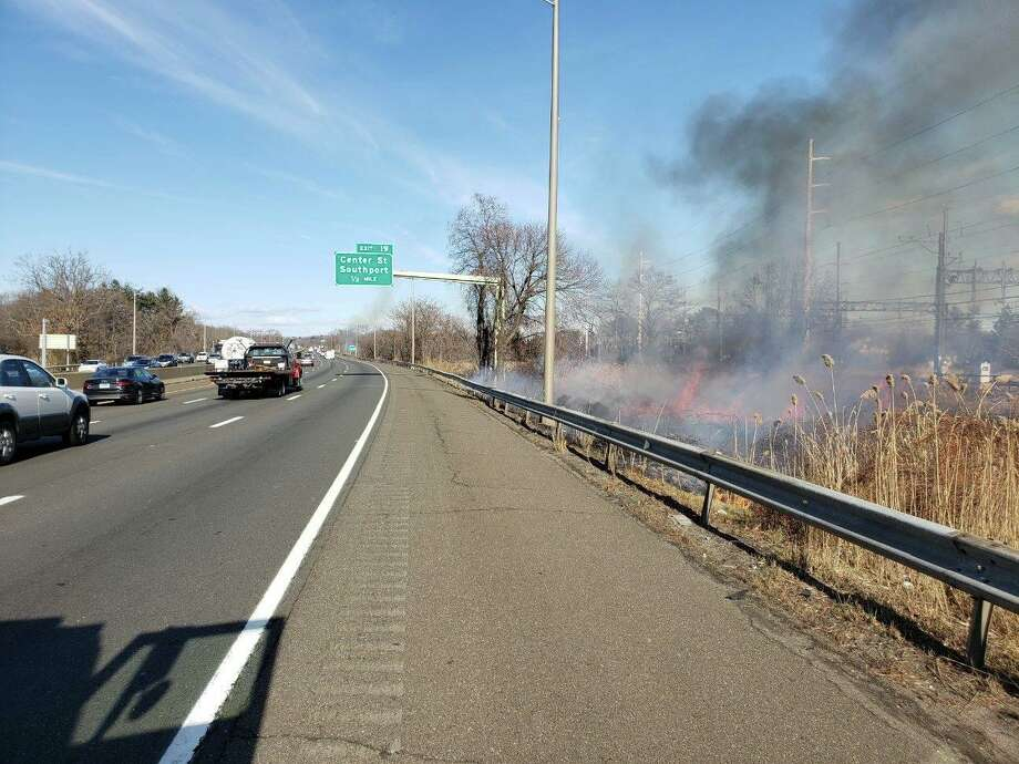 Westport and Fairfield Fire Departments responded to a fire off Interstate 95 on Wednesday. Photo: Contributed Photo
