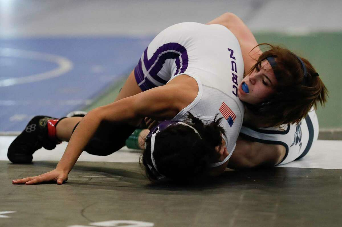 Olivia Degeorgio of College Park, shown here two weeks ago during the district meet, advanced to the semifinals of the Class 6A 95-pound weight class at the UIL Wrestling Championship Friday in Cypress.