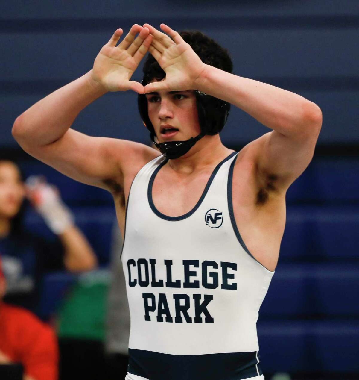 Juan Grange of College Park signals for position against Eli Sheeren of Klein in a 182-pound championship bout during the District 8-6A wrestling championships at Bryan High School, Thursday, Feb. 6, 2020, in Bryan.