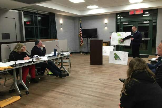 Civil engineer John Schmidts of BL Companies in Meriden, project manager for Sound Development Group LLC's project to build an Aldi grocery store and a Chase Bank on 10.6 acres at 1151 W. Main St. in Branford, speaks to the Branford Inland Wetlands Commission Feb. 13, 2020.